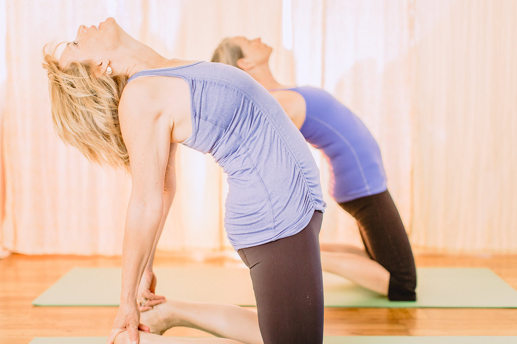 Melanee and a student in Ustrasana (Camel Pose)