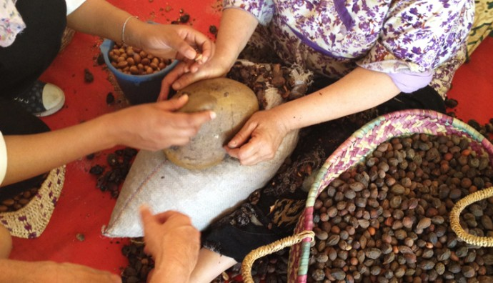 Two women cracking argan nuts in Morocco