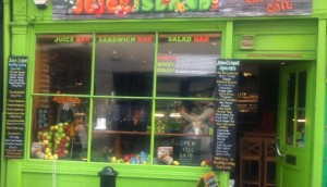 A juice bar in London with the menu written on the window