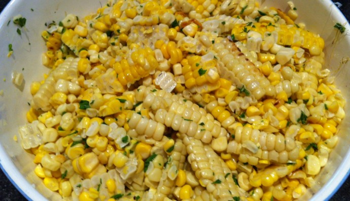 A close up of shaved grilled corn in a bowl