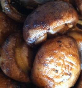 A close up picture of a few grilled mushrooms