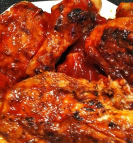 Grilled chicken covered in red sauce