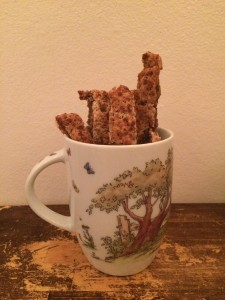 A few chewy bars in a cup on a cutting board