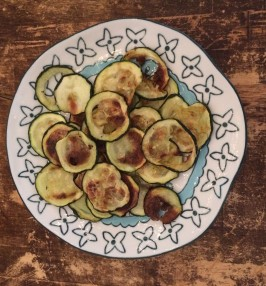 Sliced baked zucchini on a plate