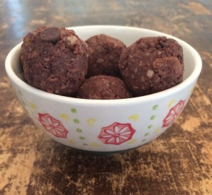 Cashew brownie balls in a small white bowl