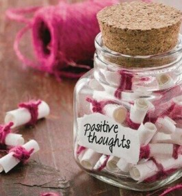 Little pieces of rolled paper in a positive thoughts jar