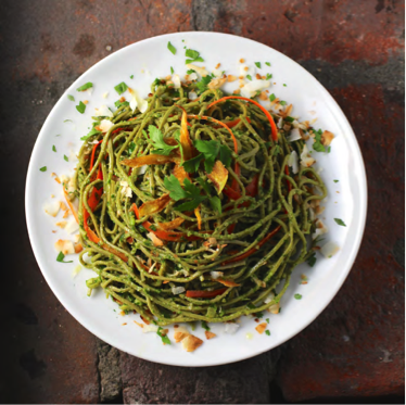 A plate with a big portion of green Edamame spaghetti