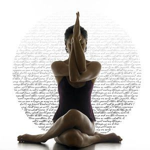 A woman sitting in the Eagle pose
