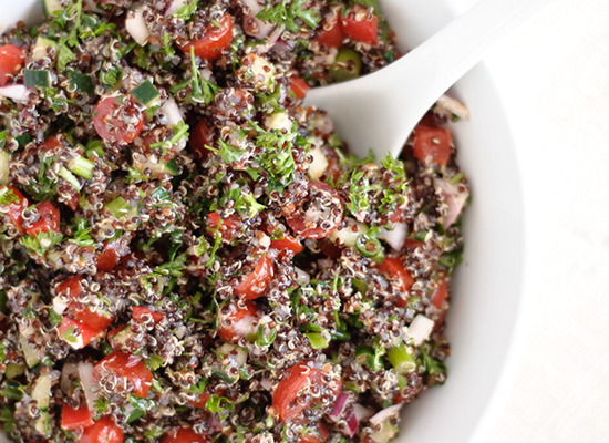 Red Quinoa Tabouli Salad in a white bowl