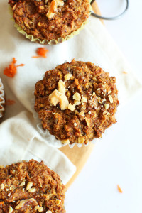 A few carrot muffins on a white kitchen towel