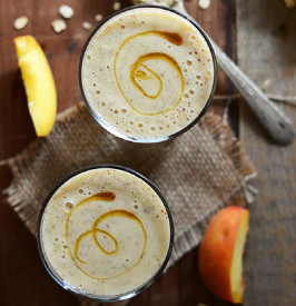 Two glasses of vegan peach and oat smoothie