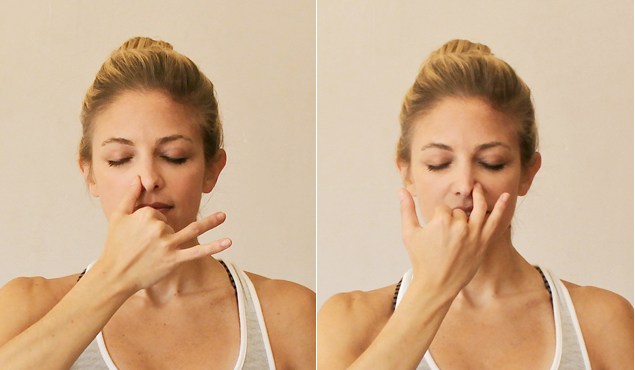 A woman doing the alternate nostril breathing practice