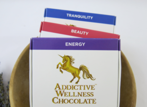 Three boxes of Addictive Wellness Chocolate