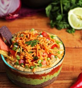 Vegan Tex-Mex layered dip in a glass bowl